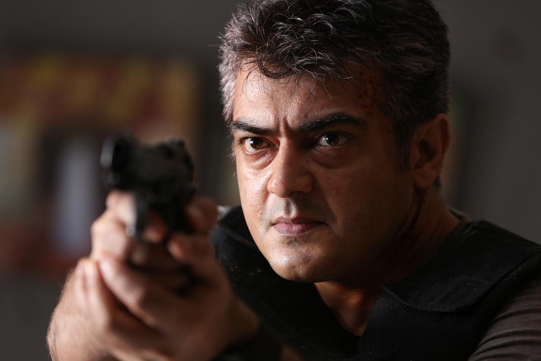 thala-ajith-aarambam-with-gun